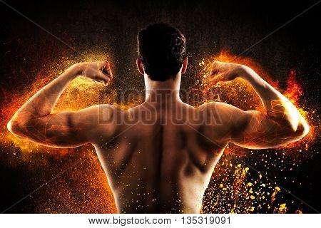 Muscular back of a man with flames