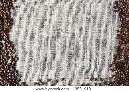 Burlap texture with coffee beans border. Sack cloth burlap texture background. Brown natural sackcloth canvas background with seeds frame and copy space. Coffee crop border at hessian textile