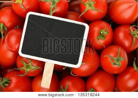 Red Cherry Tomatoes With Black Price Sign