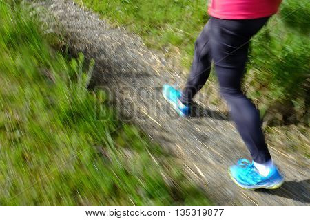 Woman hiking in mountains wilderness pink jacket and backpack fitness exploring