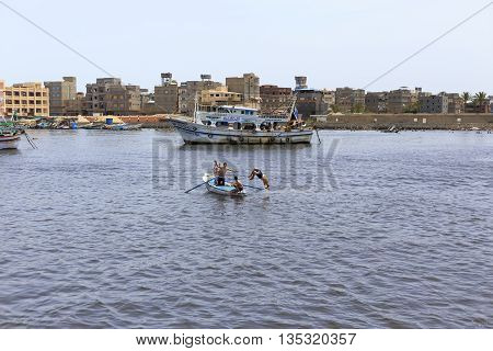 Damietta Egypt - May 13 2016: Young men swimming in river Nile.