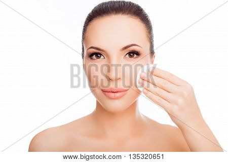 Portrait Of Young Woman Washing Off Makeup With Cotton Pad