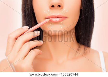 Close-up Photo Of Young Woman Doing Maquillage With Lip's Liner, Close Up Photo With Arrows