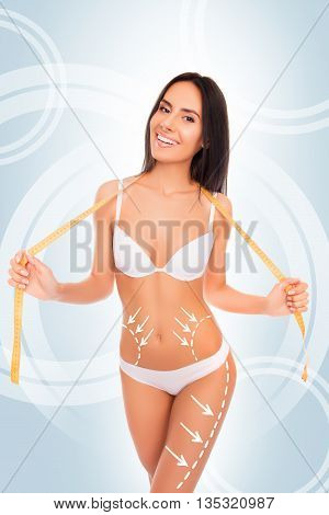 Cheerful Happy  Slim Brunette With Perfect Body  Posing With Measuring Tape