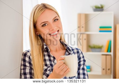 Portrait Of Young Pretty Woman Having Break And Holding Cup With Tea