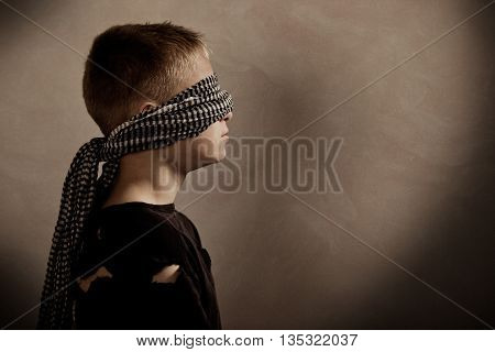 Serious Boy Blindfolded With Copy Space In Front