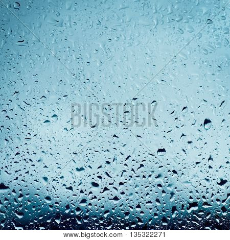 Rainy wet cold blue sky eco seasonal natural background with water drops