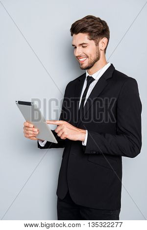 Cheerful Businessman In Suit Touching Screen Of Tablet