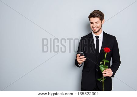 Cheerful Smiling Businessman With Rose Chatting On Gray Background
