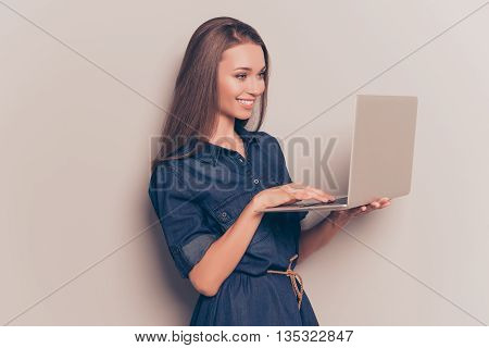 Cheerful Happy Young Woman Holding Laptop And Typing