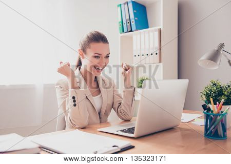 Happy Excited Successful Businesswoman Triumphing In Office