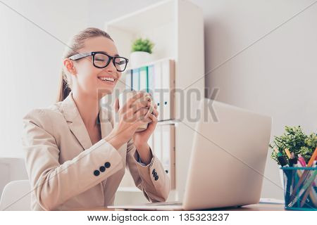 Happy Woman Having Break And Dreaming With Cup Of Coffee