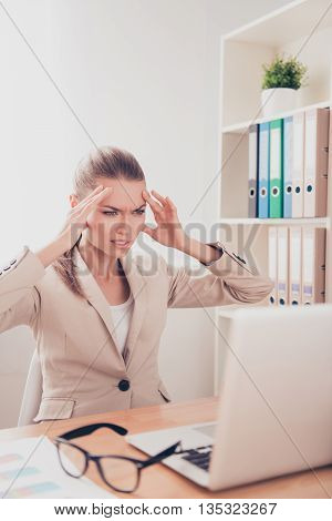 Overworked Businesswoman Feeling Strong Headache And Can't Work