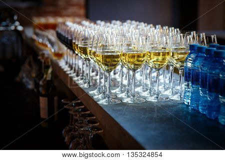catering services. glasses with champagne or wine in row background at restaurant party