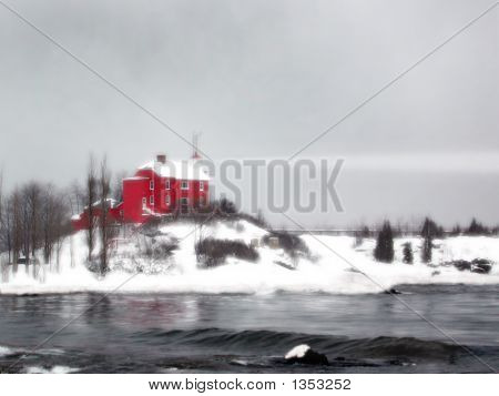 Red Lighthouse In Marquette Harbor Michigan In The Winter