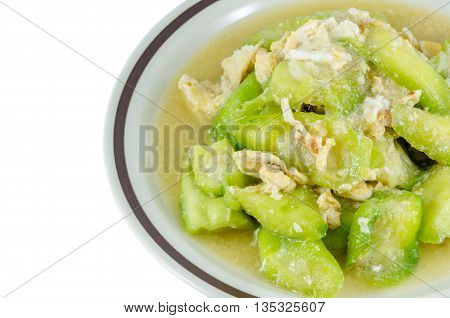 Stir fried Ridge gourd with egg over white background