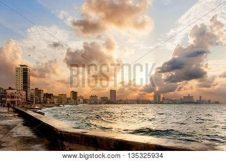 Famous embankment promenade Malecon at sunset. Havana Cuba.