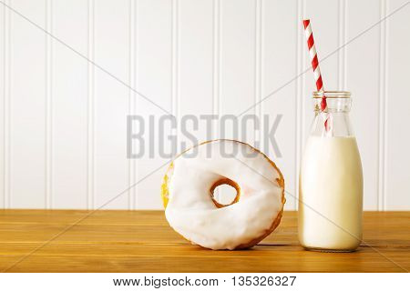 White Glazed Donut With Jar Of Milk