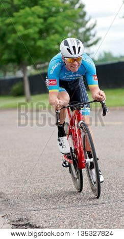 ST. PAUL, MINNESOTA - JUNE 15, 2016: The annual North Star Grand Prix pro cycling event begins with a stage one time trial in St. Paul on June 15 as a competitor races to the finish line.