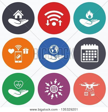 Wifi, mobile payments and drones icons. Helping hands icons. Health and travel trip insurance symbols. Home house or real estate sign. Fire protection. Calendar symbol.