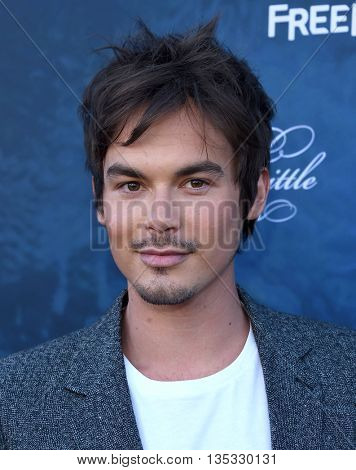 LOS ANGELES - JUN 15:  Tyler Blackburn arrives to the arrives to the Pretty Little Liars Season 7 Event  on June 15, 2016 in Hollywood, CA.
