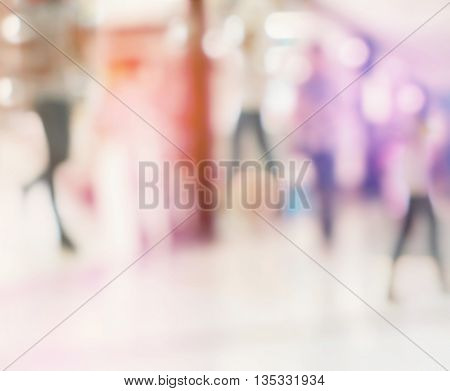 Abstract blur background image of people shopping and walking in shopping mall with vintage style.