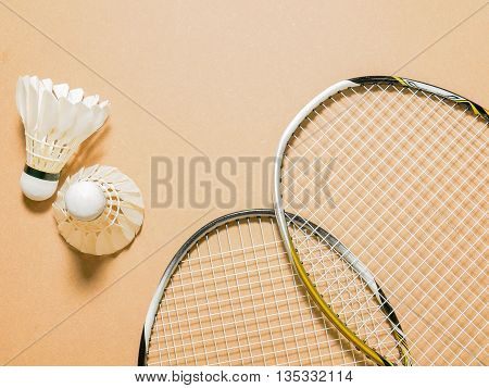 sports set of shuttlecocks with two badminton racket on plywood background