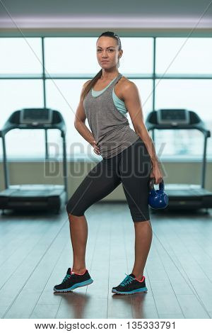 Fitness Woman Doing Exercise With Kettle Bell