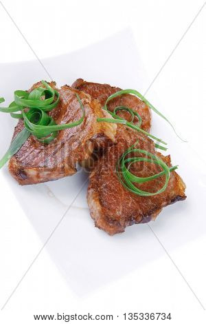 grilled meat beef steaks strips on white plate isolated over white background