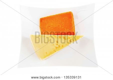 two pieces of french gourmet cheeses  on china plate isolated over white background