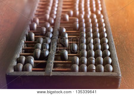 Vintage abacus on wooden background. old calculation
