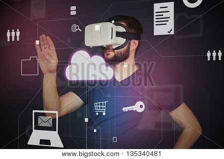 Young man in high tech VR-headset is using virtual interactive touch screen with lots of icons