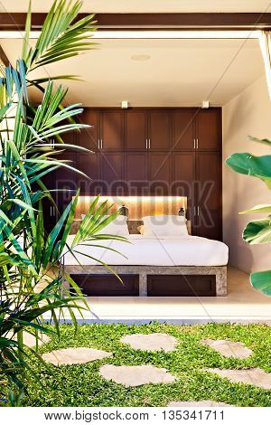 Luxury Bedroom Which Exposed To The Outside Garden Area