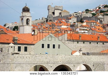 Rooftop view of Dubrovnik Croatia Old Town with church and fort