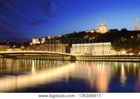 Footbridge, Courthouse And Basilica At Lyon City With Citylights, France