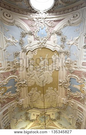 OEIRAS, PORTUGAL - November 4, 2015: The magnificent rococo stucco covering the ceiling of the Chapel of Our Lady of Mercy in the Palace of Oeiras on November 4, 2015 in Oeiras, Portugal