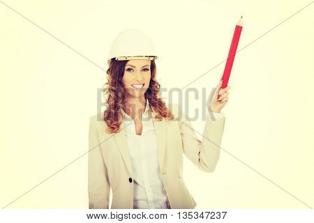 Architect woman pointing up with pencil.