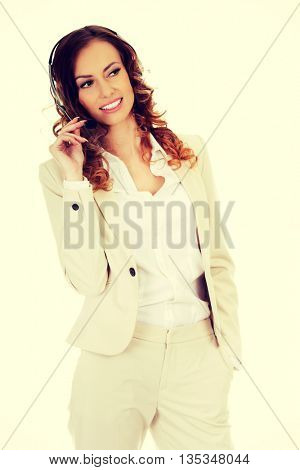 Smiling support phone operator in headset.