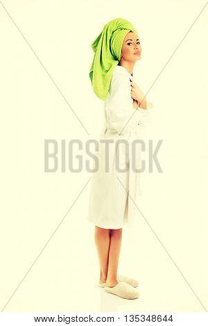 Spa woman standing in bathrobe