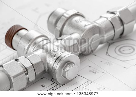 Equipment for plumbing close-up on the background of drawings