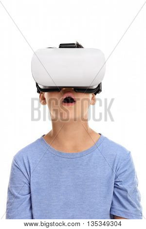 Vertical shot of an amazed little kid using a virtual reality goggles isolated on white background
