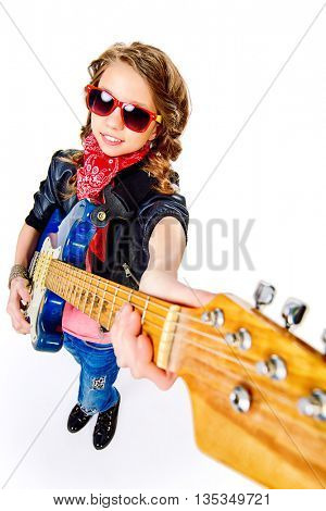 Cute teen girl playing on her electric guitar. Isolated over white.