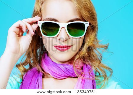 Pretty young woman in summer clothes and sunglasses.