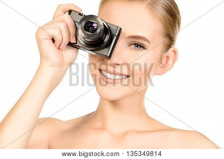 Happy smiling young woman with camera. Isolated over white.