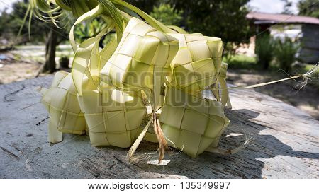 Ketupat or rice dumpling is a local delicacy during the festive season. Ketupat a natural rice casing made from young coconut leaves for cooking rice