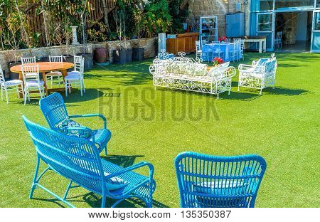 CAESARIA ISRAEL - MAY 19 2016: The summer terrace of the fish restaurant located next to the archaeological site on May 19 in Caesaria.