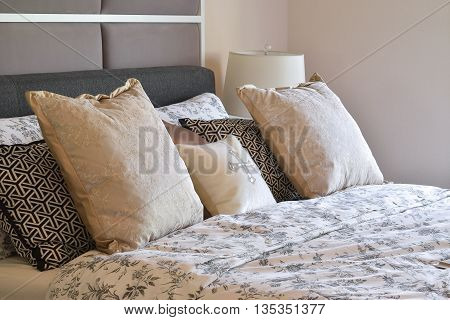 Luxury Bedroom Interior With Flower Pattern Pillows And Decorative Table Lamp