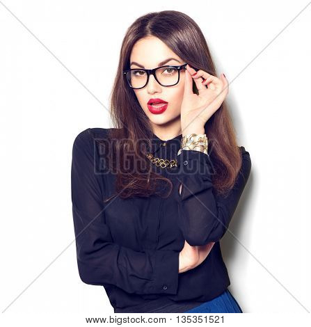 Beauty sexy fashion model girl wearing glasses, isolated on white background. Beautiful young brunette office woman with trendy accessories posing in studio