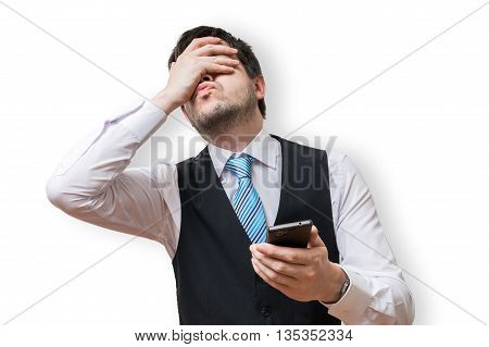 Disappointed Man Holds Smartphone And Covers His Face With Hand.