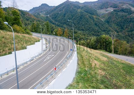 The mountain road in the ski resort Rosa Khutor in autumn day.